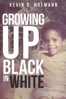book cover of smiling young black boy, Kevin Hofmann transracial adoptee
